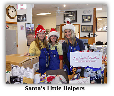 Santa's little coin shop helpers set up Christmas decorations at Southgate Coins