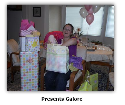Southgate Coins employee Maya Roberts receives presents at her surprise birthday shower