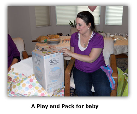 Maya receives a Play and Pack for Southgate Coins baby Embry