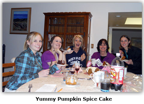 Southgate Coins employees enjoy pumpkin spice cake at Maya's surprise baby shower