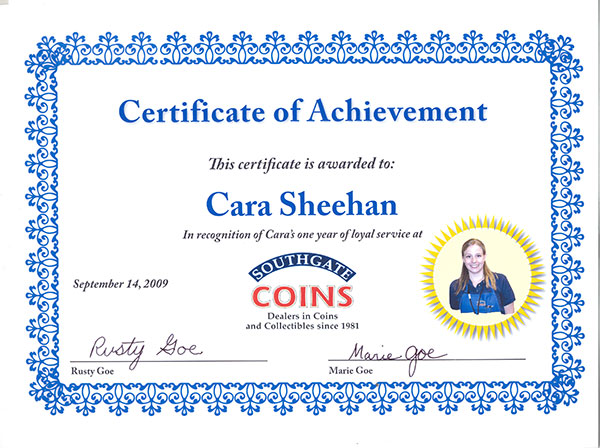 Cara receives a certificate for her one-year anniversary at Southgate Coins