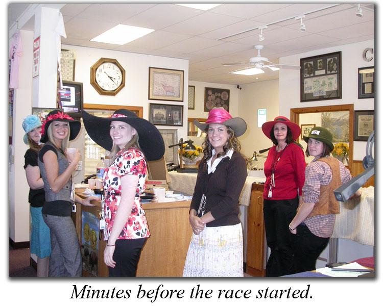 Southgate Coins staffers gather in front of the TV for the Running of the Roses