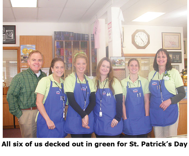 Six Southgate Coins employees dress in green for St. Patrick's Day