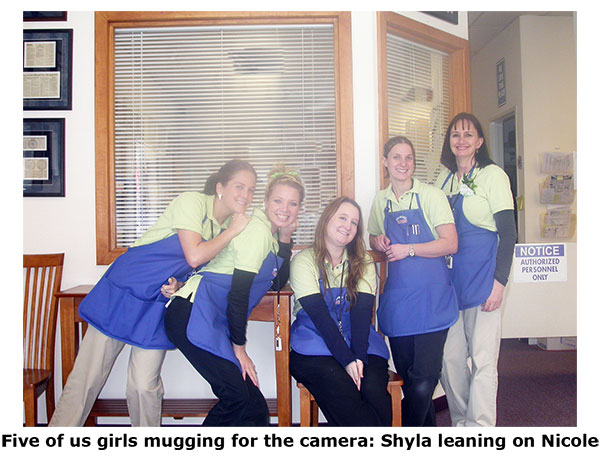 Southgate Coins staff mugs the camera on St. Patrick's Day