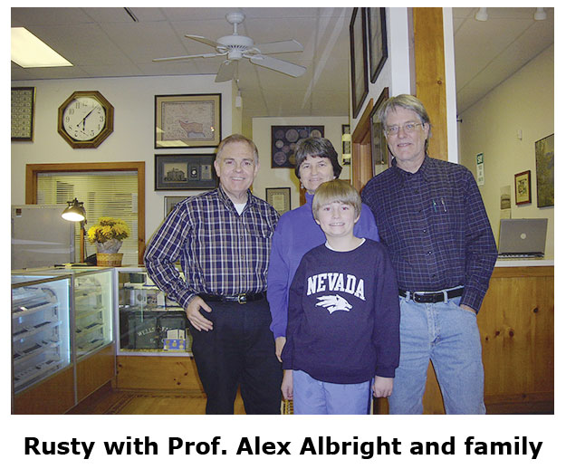 Southgate Coins owner Rusty Goe meets Professor Alex Albright and his family