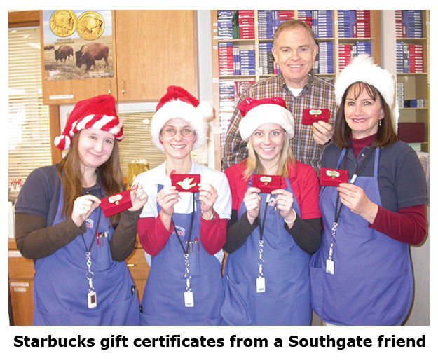 Southgate Coins staff receives a Starbucks gift card from a friend of the store