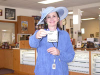 Southgate Coins owner Marie Goe holds her winning bet for Big Brown