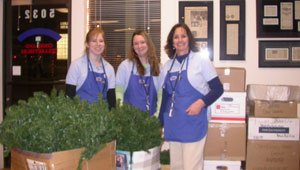 Southgate girls pose in front of the boxed Christmas tree