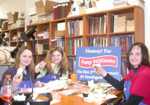Maya, Marie, and Amy pose with lunch on Amy's anniversary with the coin shop