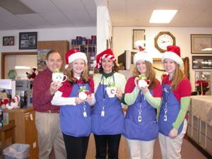 Gifts of mugs for Christmastime cheer for the Southgate Coins staff