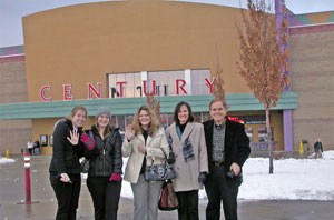 The Southgate Coins crew gathers outside the theater for their winter movie, Enchanted