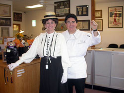 Marie as a 19th century woman, and Rusty as Emeril Lagasse