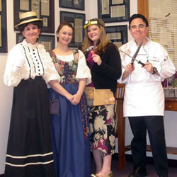 Four coin shop staffers in costume on Halloween