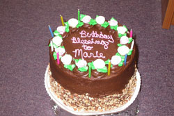 A decadent birthday cake for Marie at the coin shop