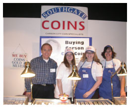 Southgate Coins staff poses at the booth at the Carson City Coin Show