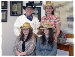 Posing with cowboy hats at Southgate Coins