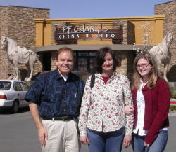 Southgate Coins owners Rusty and Marie Goe treat Amy to PF Chang's