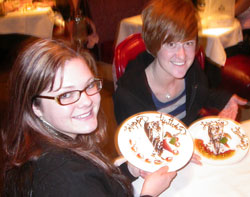 Amy and Kelsey show off their birthday cake slices courtesy of Southgate Coins