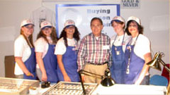 Southgate Coins staff poses at its booth at the Carson City Coin Show