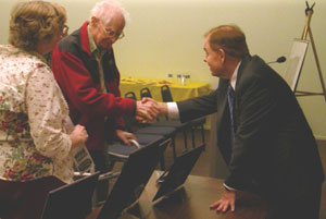 Rusty Goe meeting fans of his books and signing autographs