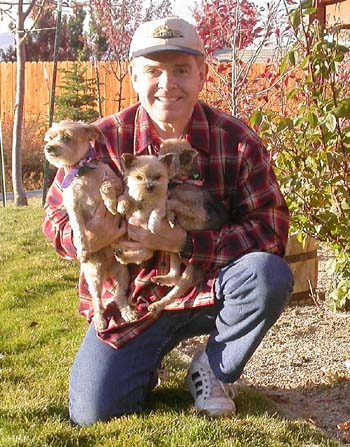Southgate Coins owner Rusty Goe with the puppies