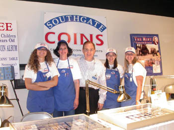 Southgate Coins employees gather at their booth at the Carson City Coin Show