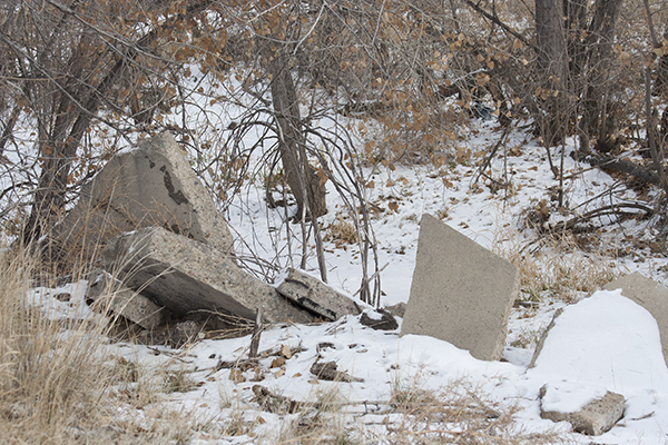 Discarded chunks of concrete sit right on the West bank of the South Platte River, Adams County Regional Park, Thornton, Colorado.