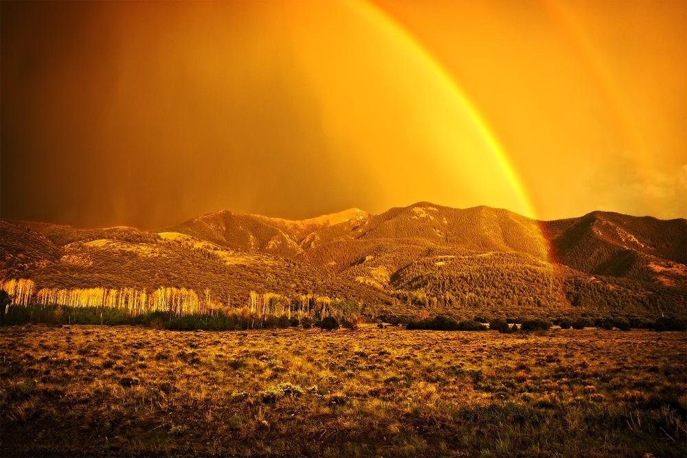 Sunset rainbow outside of Great Sand Dunes National Park, near Alamosa, Colorado.