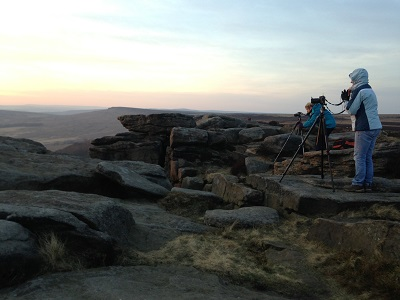 Workshop participants with Duncan Fawkes on Stanage Edge in the Peak District. Trying to snap that winner sunset.