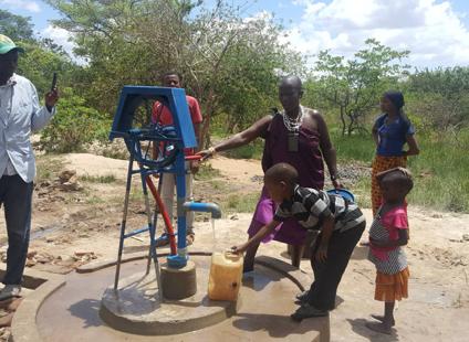 Maasai lady at pump.png