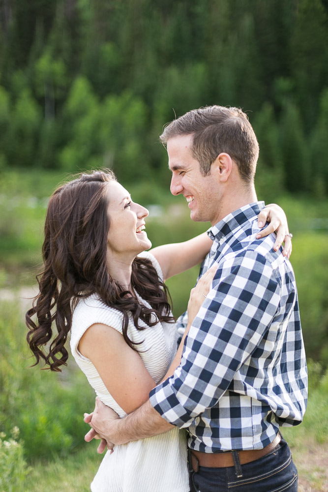 Laughing happy love engagement photos