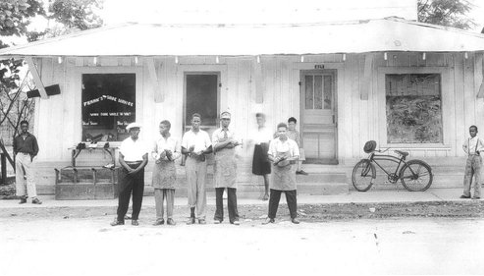 Frank Morris (in the apron and visor) is seen standing in front of his shoe shop in Ferriday, La., in the 1950s. He was killed when the shop burned down in 1964. Until now, the case has gone unsolved.   Courtesy of the Concordia Sentinel and William Brown