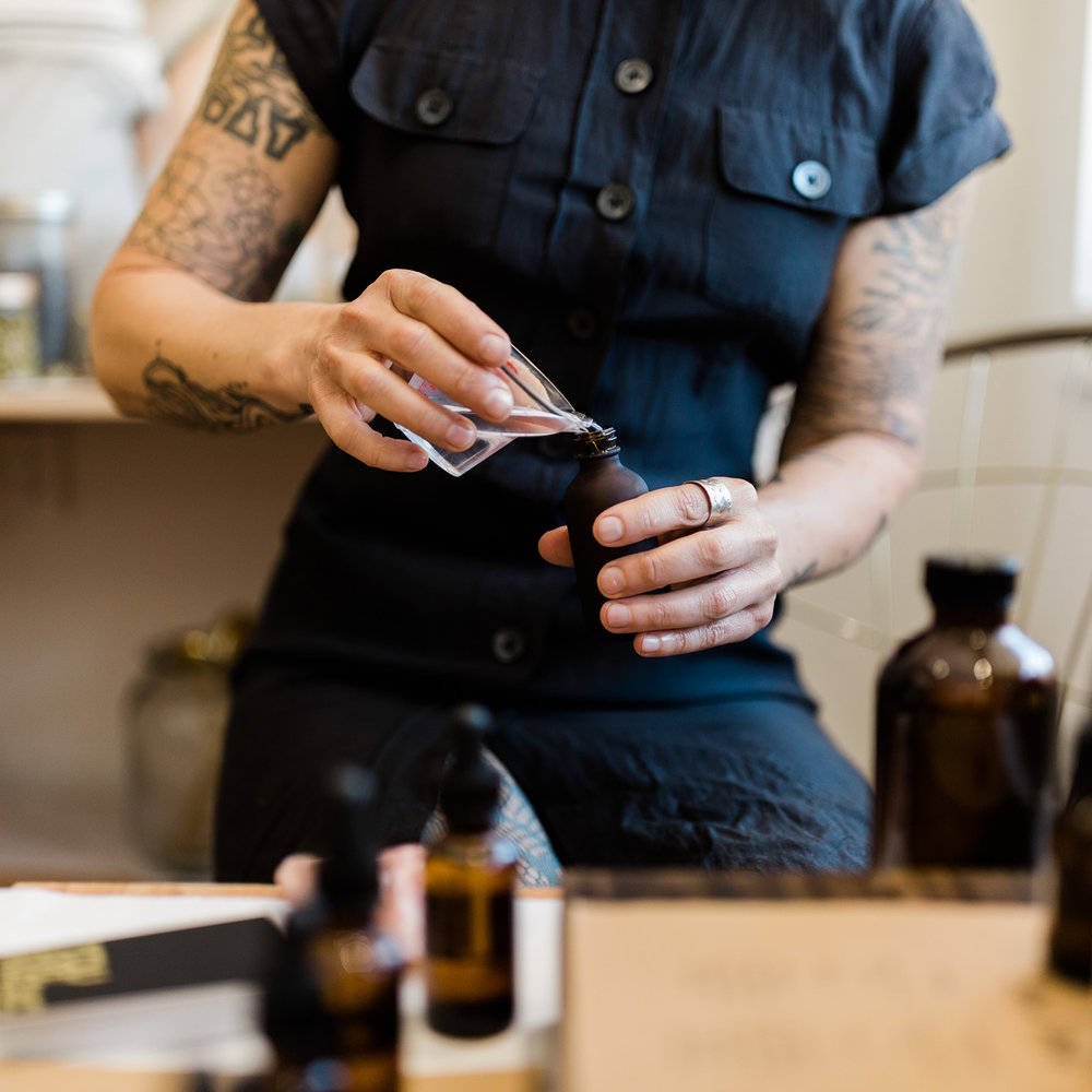"Tanya mixing up a custom ""everything spray"" at Found during a Self-Care Sunday Pop-Up in September 2018."