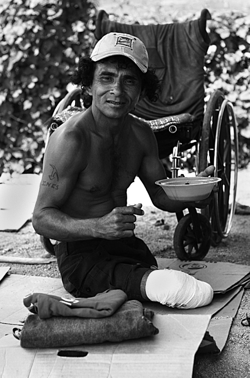 """I lost both of my legs when the train derailed…"" For several decades, the cargo train has left a river of handicapped people who lose their limbs upon falling off the train.    Ciudad Ixtepec, Oaxaca, Mexico. 2007"