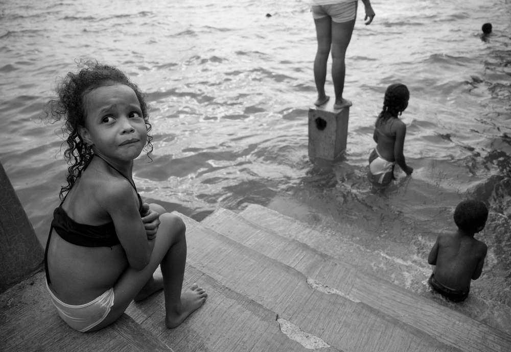 San Lorenzo, Ecuador. 2010      Children play in San Lorenzo's pier, a strategic port for newly established drug routes coming from the south of Colombia.