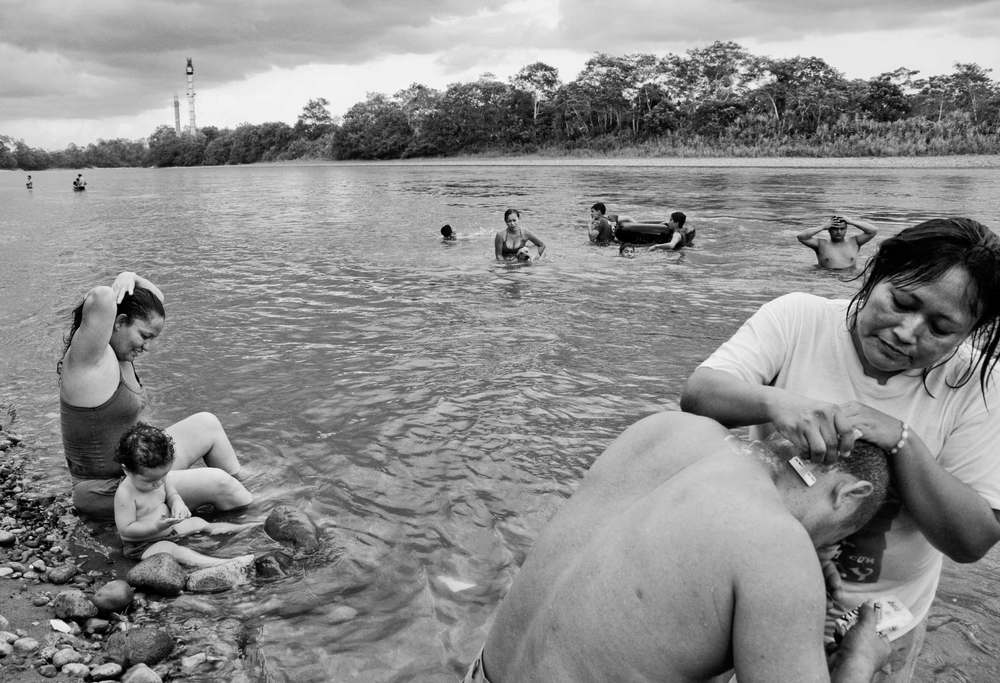 Aguarico, Ecuador. 2010     Colombian refugee and Ecuadorian families bathe in the Aguarico River in northeastern Ecuador, few kilometers away from the Colombian border.