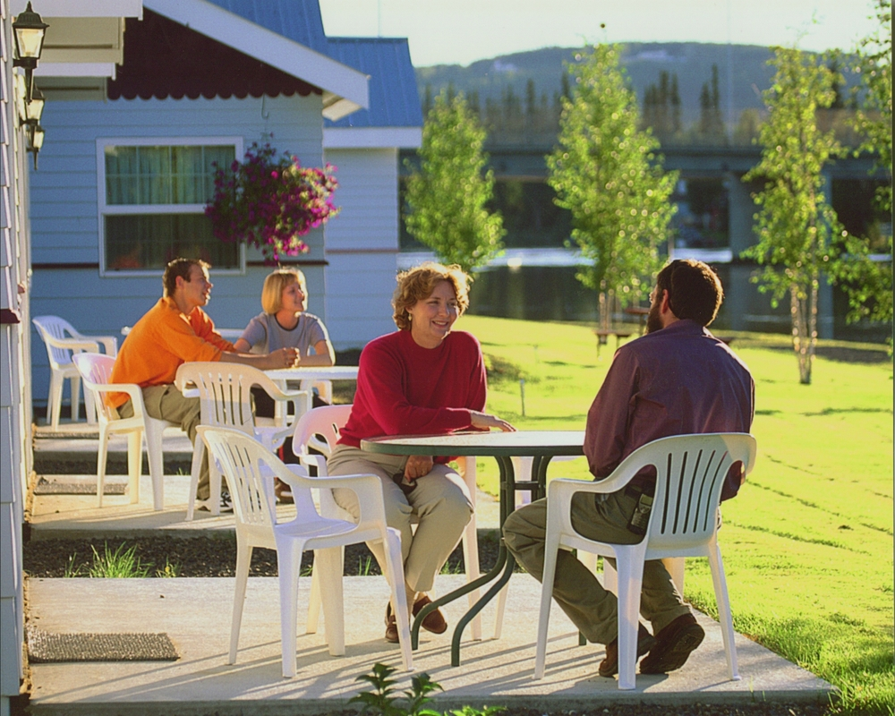 Couples enjoy our Individual Patio settings at River's Edge Resort