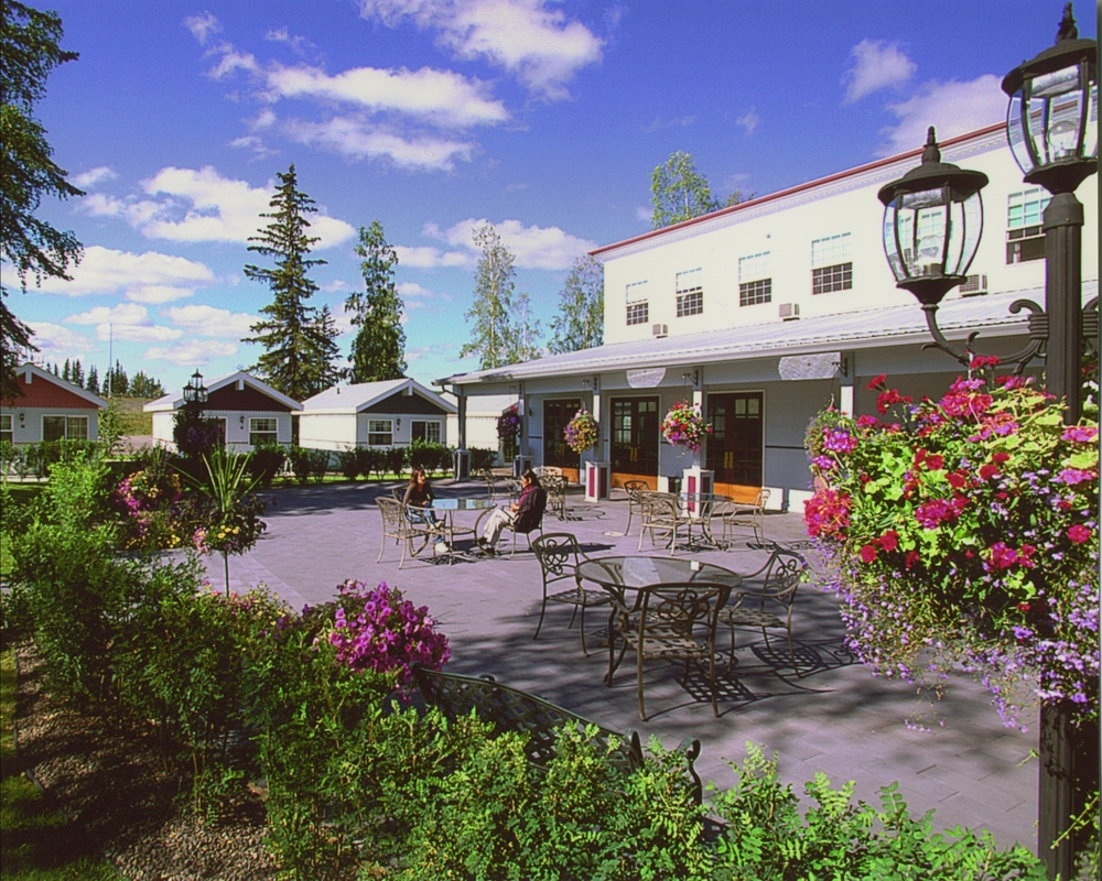 Enjoy morning coffee or linger in the midnight sun in the Lodge courtyard