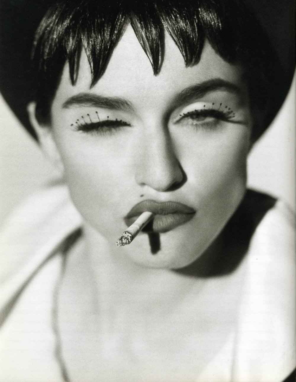 Madonna by Herb Ritts. Herb Ritts' photographs rely heavily on structure and form and other graphic qualities but he was also a master of interpreting and portraying the 'human intangible element'.
