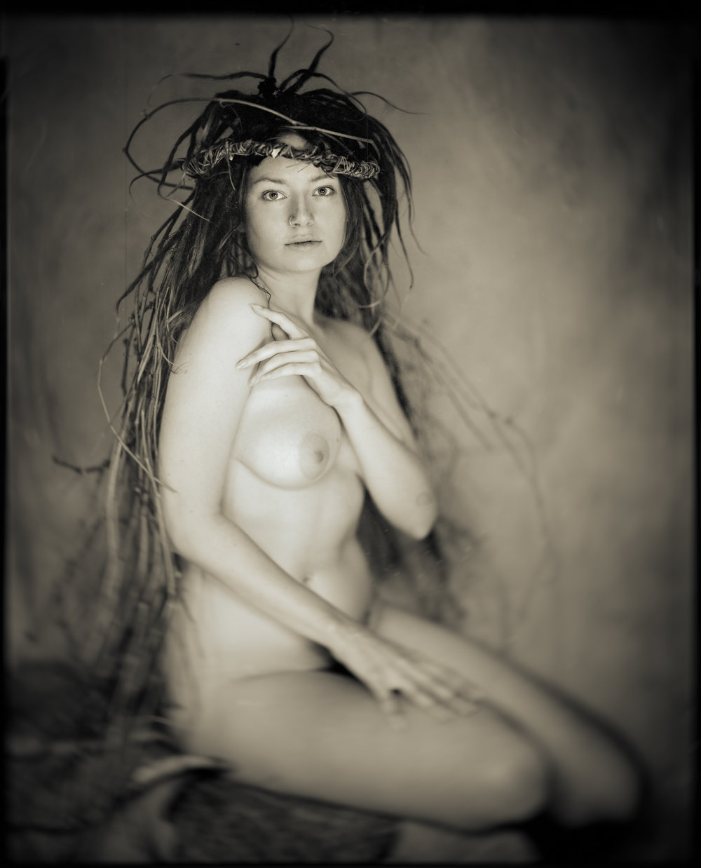"The ethereal Bianca from the ADORNED series, shot on 8x10"" film. Headpiece and styling by Gian Designs."