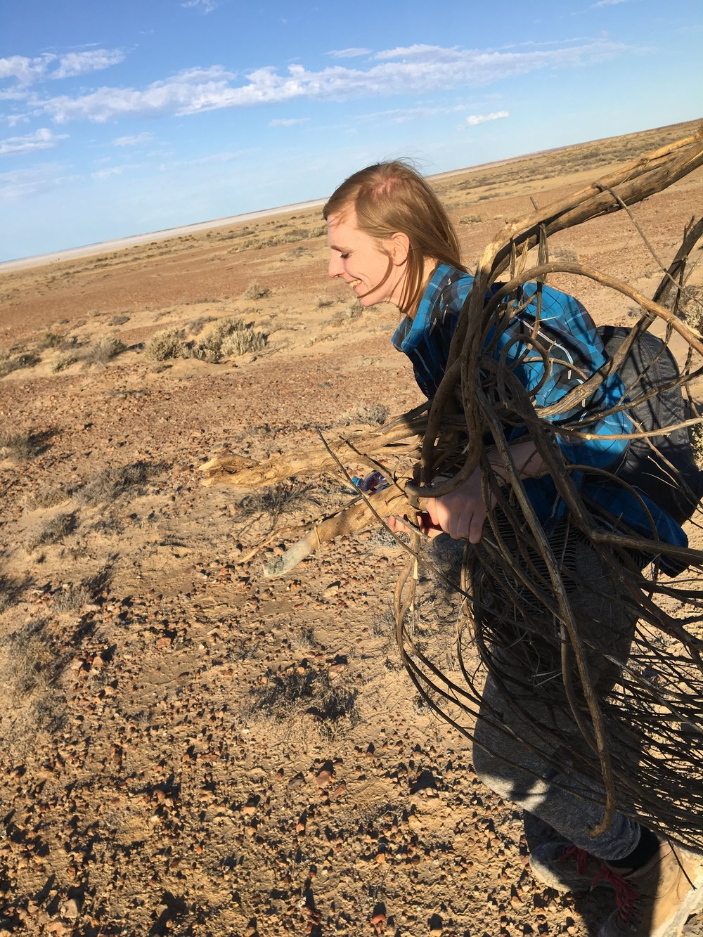 Carrying strange found desert objects.