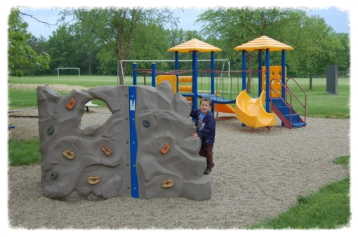 Loveless Park playground features a climbing wall for the kiddies.