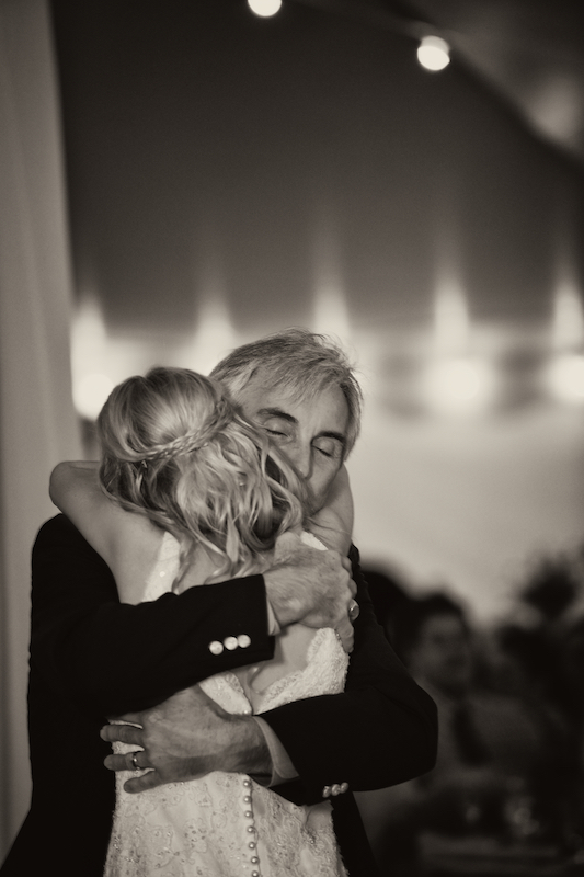 "A hug from Dad after a great Father/Daughter song choice... ""Sweet Child O' Mine"" by Guns N' Roses."