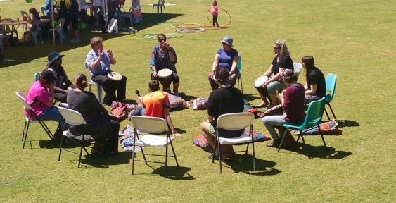 Dane in the middle recording the Drumbeat circle. Drumbeat is a program that can be used as part of therapy for someone with a mental health illness.