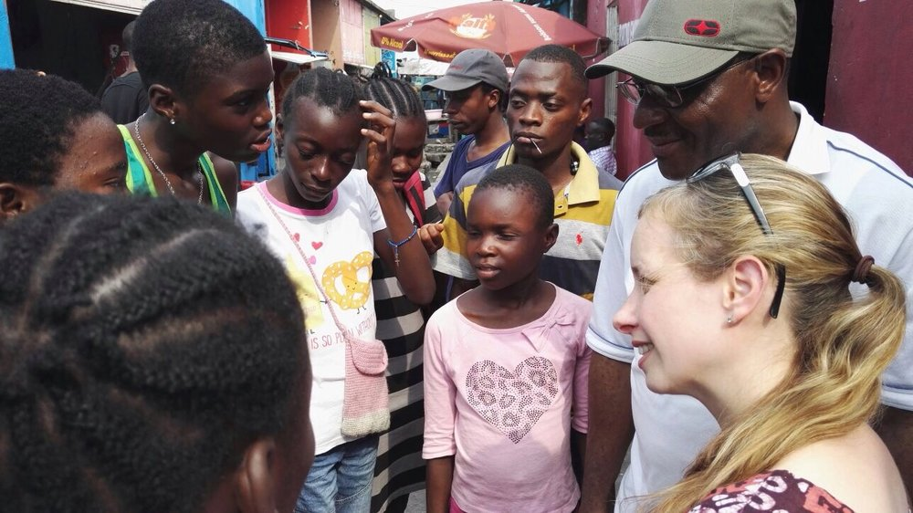 Photo Credit: Feba  Stephanie chatting with street-living children in Kinshasa