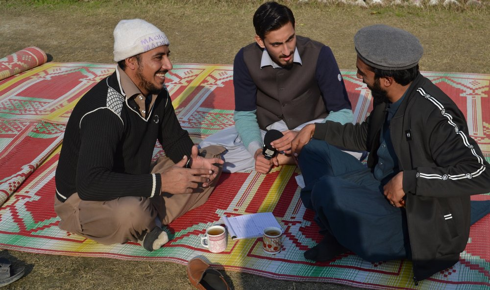 Male participants prepare a PSA incommunity centred media workshop, Pakistan, Jan 2019. (HCR Pakistan)