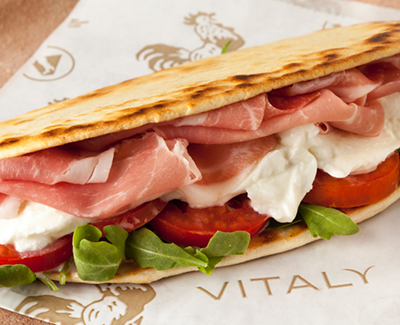 A piadina flatbread sandwich at Vitaly. Freshly baked piadina, imported  prosciutto, buffalo mozzarella, fresh lettuce and  Roma tomatoes make for a splendid lunch. (Source: Vitaly)