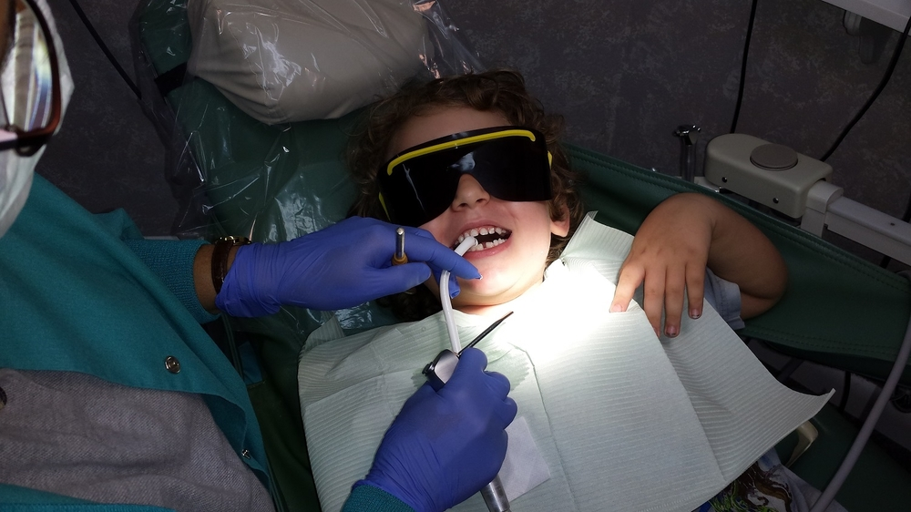 avi teeth cleaning with shades on 1500 pixels.jpg