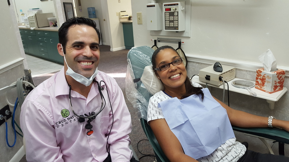 Dr. Cruz-Davis and a bright-smiled patient in our Gainesville FL dental office