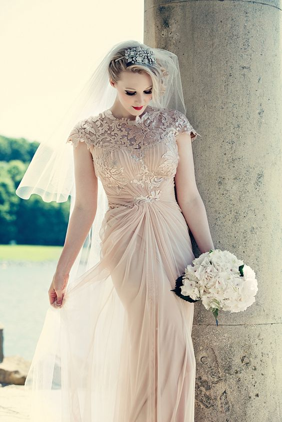 Pale gold chiffon with dramatic detailing on the bodice.